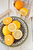 Lemons and oranges on a ceramic plate