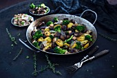 Pan fried vegetables with violet and yellow potatoes, broccoli, mushrooms, tofu and shallots (Vegan)