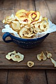 A bowl of banana, pear, apple and peach crisps