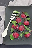 Beetroot ravioli with mixed salad leaves