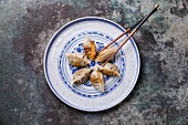 Korean Fried Dumplings Cham on metal textured background