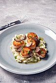 Seared scallops served on a bed of mashed parsnips with sliced truffles