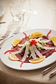 Bresaola with parmesan strips and orange slices