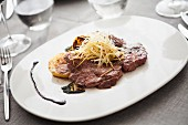 Beef entrecote with vegetables and shredded potatoes