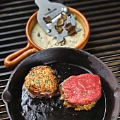 Beef steak with a cheese and herb crust and truffled polenta