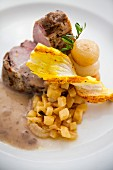 Pork fillet with apples, borettane onions and a saffron puff pastry stick