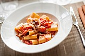 Pasta amatriciana with tomato sauce and bacon