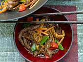 Wok-fried beef with vegetables and orange