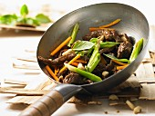 Wok-fried beef and shiitake with carrots and Thai basil