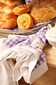 Hand-sewn linen napkins next to tray of pastries