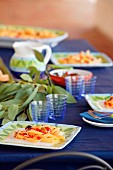 Penne pasta with tomatoes on blue table