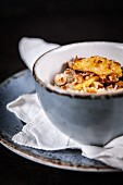 Porridge with apples, caramelised hazelnuts and coconut flakes