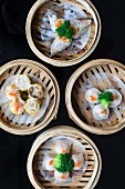 Various Chinese steamed dumplings in bamboo steaming baskets