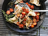 Potato ravioli with stewed cherry tomatoes and thyme