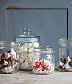 Small meringue drops in storage jars