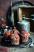 Chocolate cupcakes served with chocolate sauce
