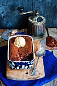 Chocolate cake served hot from the oven with a scoop of vanilla ice cream