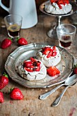 Mini pavlovas with strawberries and chocolate