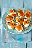 Eggs with smoked salmon, caviar and shoots