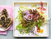 Brasserie salad with a poached egg