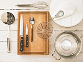 Kitchen utensils for the preparation of a brasserie salad with a poached egg