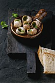 Escargots de Bourgogne - Snails with herbs butter, gourmet dish with parsley and sliced bread