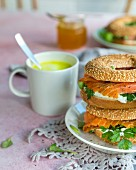 Bagels with salmon, parsley and cream cheese with turmeric coffee for breakfast