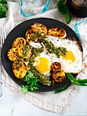 Fried eggs with plantain and chimichurri sauce for breakfast