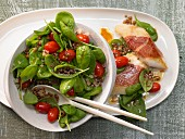 Spinach salad with lentils and zander wrapped in parma ham