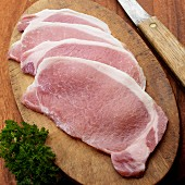 Raw English style bacon on cutting board