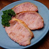 Fried English style bacon on plate