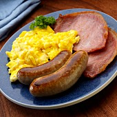 Scrambled eggs with two bangers and two English bacon