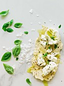 Parmesan crisps with basil oil and mozzarella