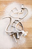 Various kneading hooks on a worktop dusted with flour