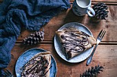 Crepes drizzled with chocolate and ground almonds