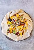 A galette with nectarines, figs and almond flakes (unbaked)