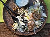 A Waldorf cabbage salad with pork fillets