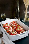 Black Rice Caprese Stuffed Roasted Red Peppers served with a fresh Basil Oil and white wine