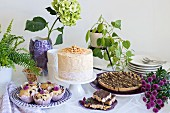 A cake buffet with peanut cake and biscuits