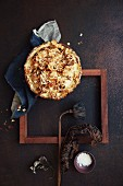 Cauliflower pie with cheese and almond flakes