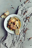 Chicken with olives and white bread