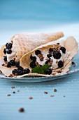 Waffles with vegan vanilla cream, blackberries and crunchy muesli