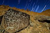 Atacama rock art and star trails, time-exposure image