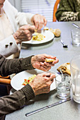 Elderly person eating