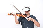 Violinist wearing a virtual reality headset