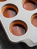Making of chocolate peanut butter cups