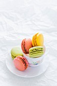 Assorted Colorful Macarons in a Tea Cup
