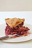 Sour Cherry Pie sliced on a white plate