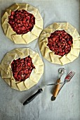 Cranberry pies being made on a parchment paper, USA