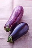 Two aubergines on a linen cloth